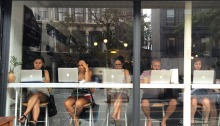 People Sitting at Coffee Shop Window with Computer