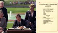 George H.W. Bush signing the Americans with Disability Act with adjacent image of the cover page for the law.