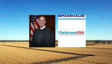 Photo of Judge Joseph F. Bataillon with logos of Spamhaus and DatabaseUSA over wheat field.